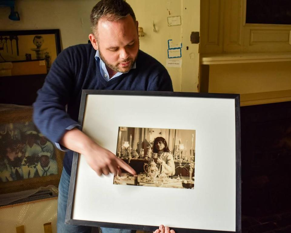 """Historian Jonathan Coleman displays a photograph of James Herndon, better known as the Lexington crossdresser Sweet Evening Breeze, an important figure in Coleman's upcoming book, """"Anywhere Together: A Queer History of Kentucky."""""""