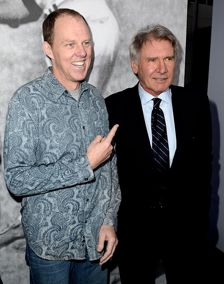 "LOS ANGELES, CA - APRIL 09:  Writer/director Brian Helgeland (L) and actor Harrison Ford arrive at the premiere of Warner Bros. Pictures' and Legendary Pictures' ""42"" at the Chinese Theatre on April 9, 2013 in Los Angeles, California.  (Photo by Kevin Winter/Getty Images)"