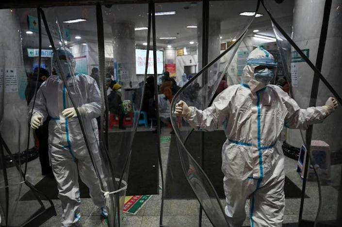 In China's Wuhan city, the epicentre of the deadly epidemic, hospitals are overwhelmed (AFP Photo/Hector RETAMAL)