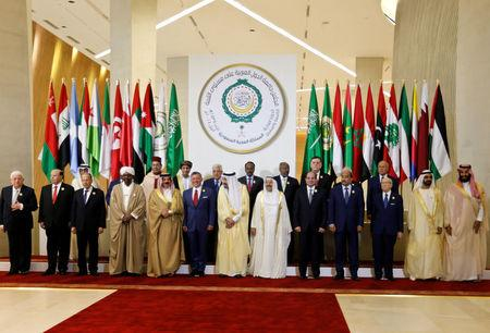 Arab leaders pose for the camera, ahead of the 29th Arab Summit in Dhahran, Saudi Arabia