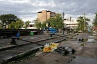 Lamp posts damaged due to typhoon Phanfone lie on a road in Ormoc City