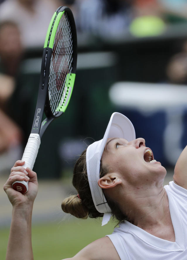 Romania's Simona Halep serves to Ukraine's Elina Svitolina in a Women's semifinal singles match on day ten of the Wimbledon Tennis Championships in London, Thursday, July 11, 2019. (AP Photo/Ben Curtis)
