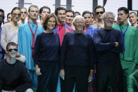 Silvana Armani from centre left, Giorgio Armani and Leo Dell'Orco stand with models after the Emporio Armani Spring Summer 2022 collection during Milan Fashion Week, in Milan, Italy, Thursday, Sept. 23, 2021. (AP Photo/Luca Bruno)