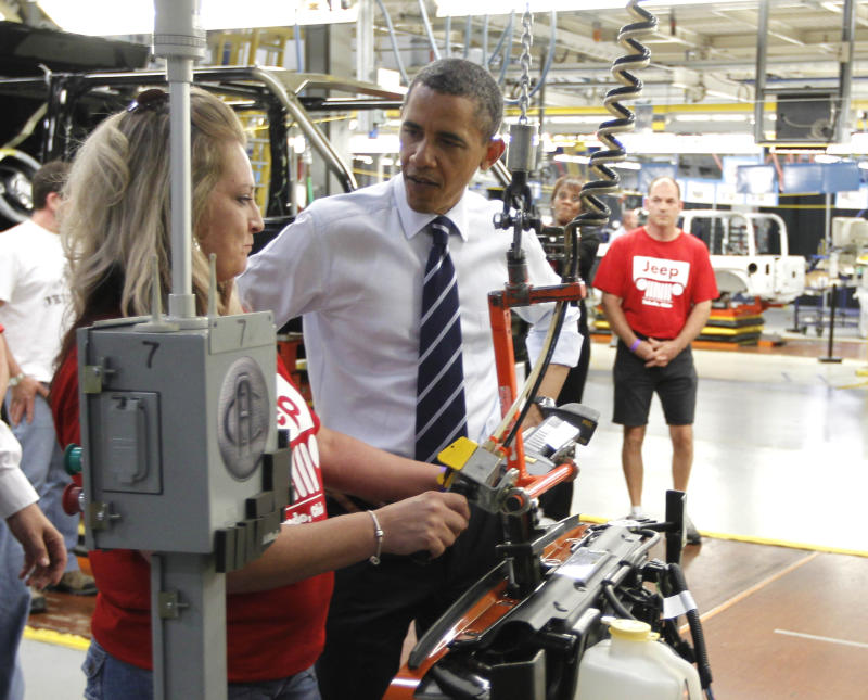 FILE - In this Friday, June 3, 2011 file photo, President Barack Obama tours Chrysler Group's Toledo Supplier Park in Toledo, Ohio. The economy President Obama will face over the next four years remains slow and at risk, but signs suggest that the next four years will coincide with a vastly healthier economy than the previous four, which overlapped the Great Recession.  (AP Photo/Charles Dharapak, File)