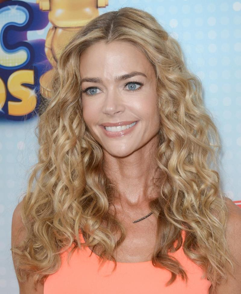 FILE - In this April 27, 2013 file photo, Denise Richards arrives at the Radio Disney Music Awards at the Nokia Theatre in Los Angeles. Charlie Sheen said Friday, May 3, 2013, that he supports a decision by child protective services to temporarily place his twin sons with former wife, Brooke Mueller with the actor's other ex-wife, Denise Richards. (Photo by Richard Shotwell/Invision/AP, File)