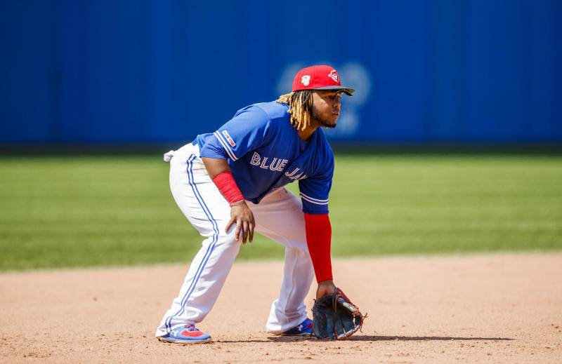 TORONTO, ONTARIO - JULY 07: Vladimir Guerrero Jr. #27 of the Toronto Blue Jays gets in fielding position against the Baltimore Orioles in the ninth inning during their MLB game at the Rogers Centre on July 7, 2019 in Toronto, Canada. (Photo by Mark Blinch/Getty Images)