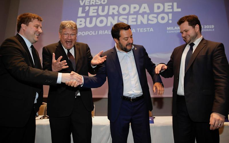 From left, Olli Kotro, leader of The Finns Party, Jorg Meuthen, leader of Alternative For Germany party, Matteo Salvini, Italian deputy PM and leader of the League party, and Anders Vistisen, leader of the Danish People's Party, join hands at the press conference in Milan  - AP
