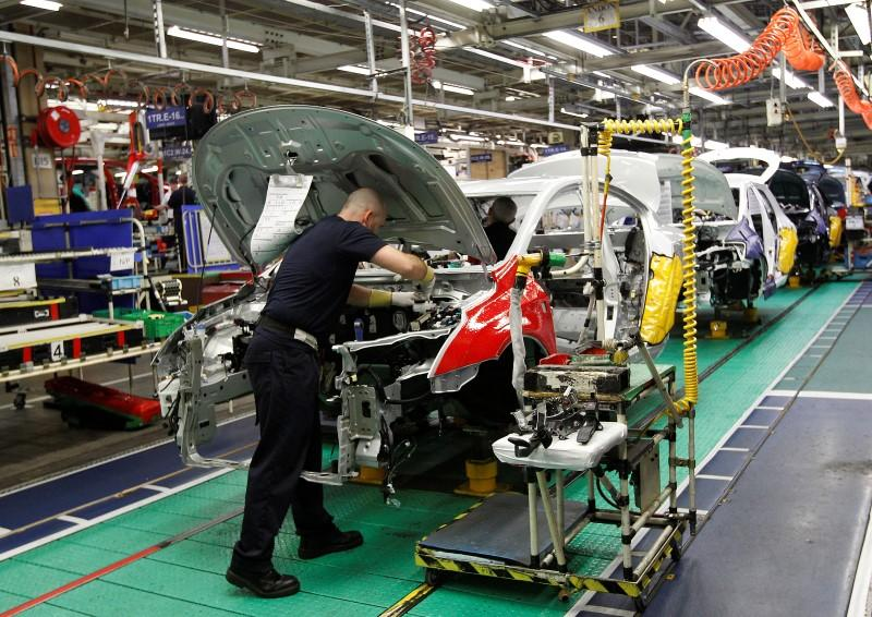FILE PHOTO: A man works on the production line at the Toyota factory in Derby