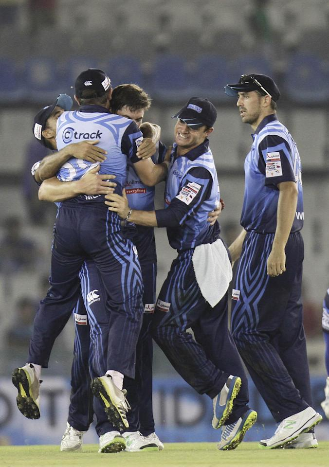 Titans players celebrate the fall of wicket during the Champions League T20, 6th match, Group B, between Brisbane Heat and Titans at Mohali stadium, Chandigarh  on Sept. 24, 2013. (Photo: IANS)