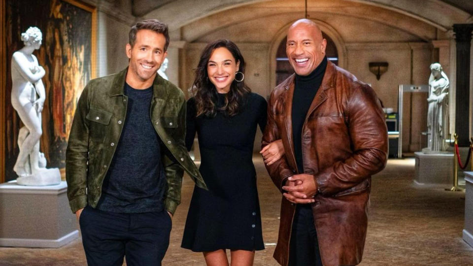 Ryan Reynolds, Gal Gadot and Dwayne Johnson are set to join forces in 'Red Notice'. (Credit: Hiram Garcia/Dwayne Johnson/Instagram)
