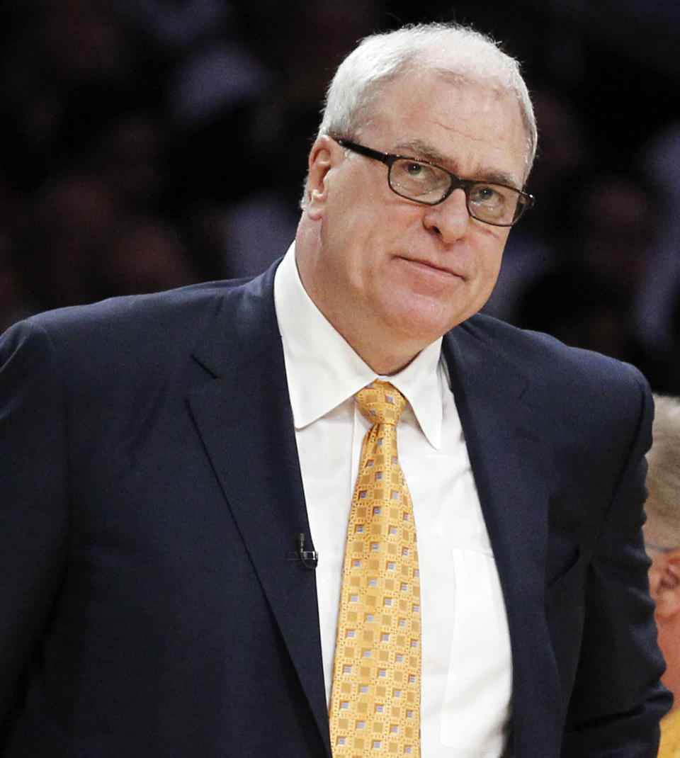 """FILE - In this June 6, 2010 file photo, Los Angeles Lakers coach Phil Jackson watches during the first half of Game 2 of the NBA basketball finals against the Boston Celtics, in Los Angeles. Carmelo Anthony says he has heard that 11-time NBA champion coach Phil Jackson will be """"coming on board"""" in a leadership capacity with the New York Knicks, though cautioned that nothing is yet official. Anthony made the comments Wednesday, March 12, 2014, to reporters in Boston, where the Knicks are playing the Celtics. (AP Photo/Chris Carlson, FILE)"""