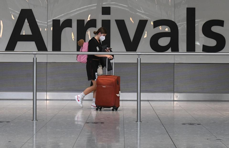 A passenger arrives in to Heathrow (AFP via Getty Images)