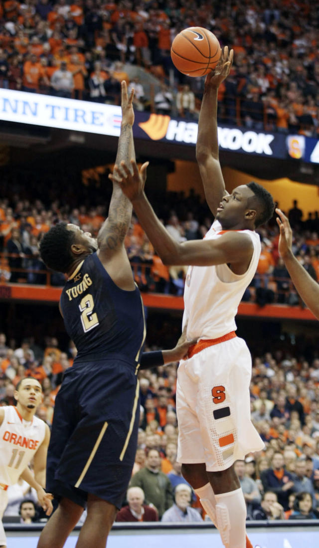 Syracuse's Jerami Grant, right, shoots over Pittsburgh's Michael Young (2) in the second half of an NCAA college basketball game in Syracuse, N.Y., Saturday, Jan. 18, 2014. Syracuse won 59-54. (AP Photo/Nick Lisi)