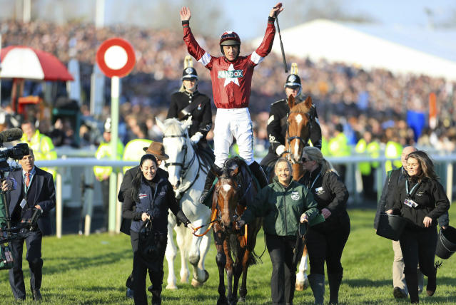Tiger Roll ridden by jockey Davy Russell after winning the Grand National Handicap Chase at the Grand National Horse Racing Festival at Aintree Racecourse, near Liverpool, England, Saturday April 6, 2019. (Mike Egerton/PA via AP)