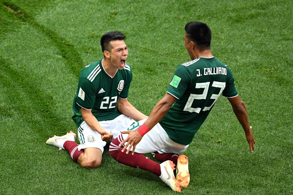 <p>Hirving Lozano of Mexico celebrates with Jesus Gallardo by sliding on their knees after scoring his team's first goal during the 2018 FIFA World Cup Russia group F match between Germany and Mexico at Luzhniki Stadium on June 17, 2018 in Moscow, Russia. (Photo by Matthias Hangst/Getty Images) </p>