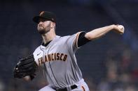 San Francisco Giants starting pitcher Alex Wood throws against the Arizona Diamondbacks during the first inning of a baseball game, Thursday, Aug. 5, 2021, in Phoenix. (AP Photo/Ross D. Franklin)
