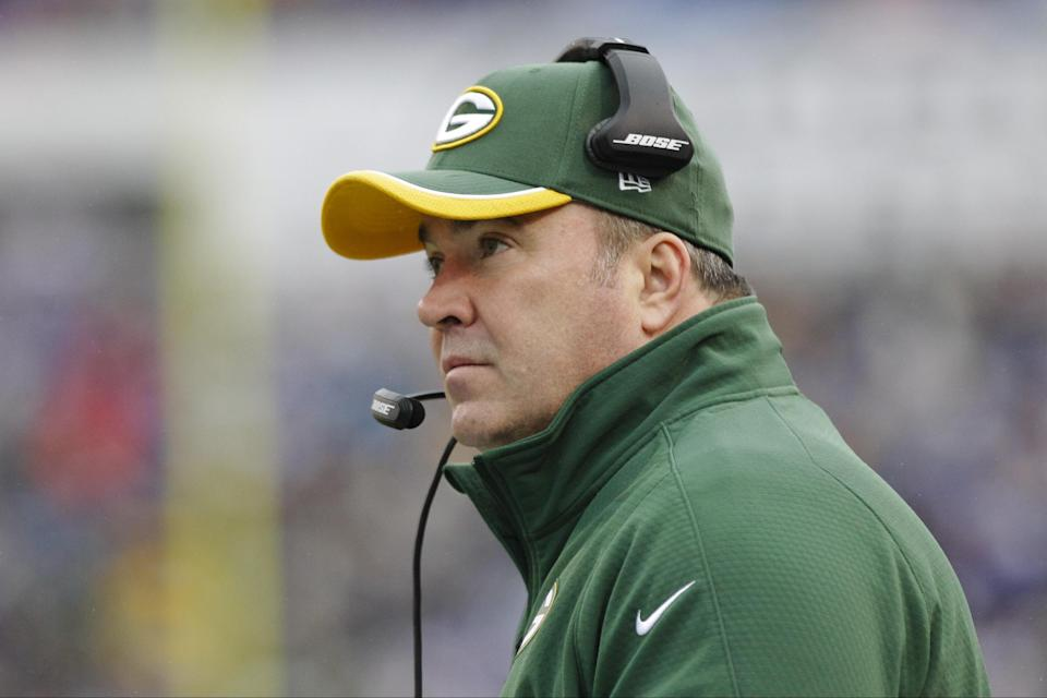 Green Bay Packers head coach Mike McCarthy watches his team play during the first half of an NFL football game against the Buffalo Bills Sunday, Dec. 14, 2014, in Orchard Park, N.Y. (AP Photo/Bill Wippert)
