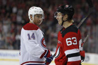 Montreal Canadiens center Nick Suzuki (14) watches New Jersey Devils left wing Jesper Bratt (63) smiles after scoring a goal during the second period of an NHL hockey game Tuesday, Feb. 4, 2020, in Newark, N.J. (AP Photo/Kathy Willens)