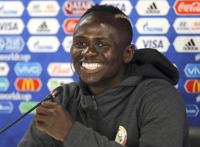 Senegal's Sadio Mane smiles during the official press conference on the eve of the group H match between Japan and Senegal at the 2018 soccer World Cup in the Yekaterinburg Arena in Yekaterinburg, Russia, Saturday, June 23, 2018. (AP Photo/Eugene Hoshiko)
