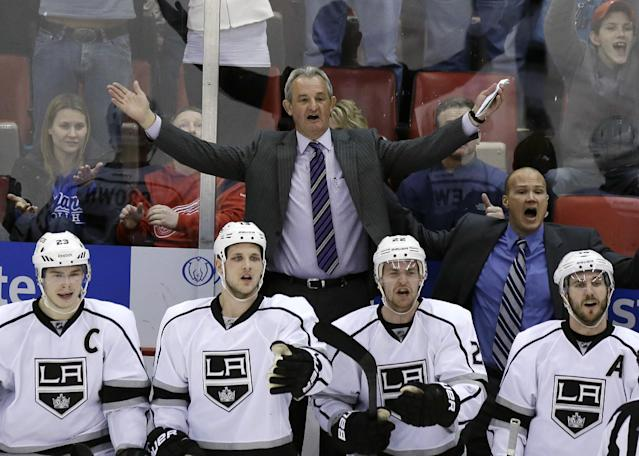Los Angeles Kings head coach Darryl Sutter, top, reacts after the Detroit Red Wings were awarded the tying goal during the third period of an NHL hockey game in Detroit, Saturday, Jan. 18, 2014. (AP Photo/Carlos Osorio)