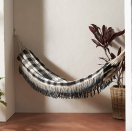 """<p><strong>Anthropologie</strong></p><p>anthropologie.com</p><p><strong>$118.00</strong></p><p><a href=""""https://go.redirectingat.com?id=74968X1596630&url=https%3A%2F%2Fwww.anthropologie.com%2Fshop%2Fjuana-hammock&sref=https%3A%2F%2Fwww.elledecor.com%2Fshopping%2Fg37001286%2Fbest-indoor-hammocks%2F"""" rel=""""nofollow noopener"""" target=""""_blank"""" data-ylk=""""slk:Shop Now"""" class=""""link rapid-noclick-resp"""">Shop Now</a></p><p>This black and white buffalo check hammock will go with almost any look in any part of your home.</p>"""