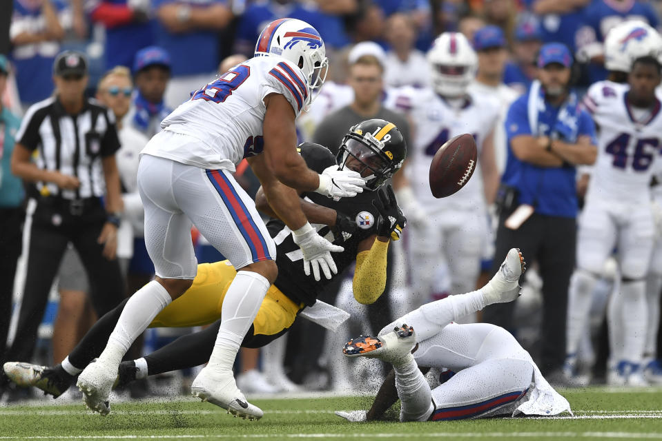Buffalo Bills outside linebacker Matt Milano (58) breaks up a pass intended for Pittsburgh Steelers wide receiver JuJu Smith-Schuster (19) during the second half of an NFL football game in Orchard Park, N.Y., Sunday, Sept. 12, 2021. (AP Photo/Joshua Bessex)