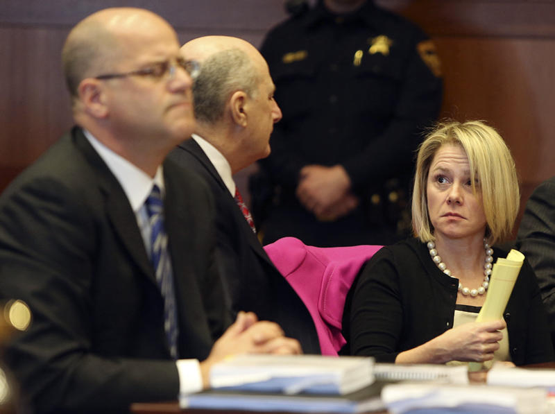 New Jersey Gov. Chris Christie's former Deputy Chief of Staff Bridget Anne Kelly, right, talks with her attorney Michael Critchley, center, as former Christie campaign director William Stepien's attorney Kevin Marino, left, looks on during a hearing Tuesday, March 11, 2014, in Trenton, N.J. Attorneys for Kelly and Stepien were in court to try to persuade a judge not to force them to turn over text messages and other private communications to New Jersey legislators investigating the political payback scandal ensnaring Christie's administration. (AP Photo/The Record of Bergen County, Chris Pedota, Pool)