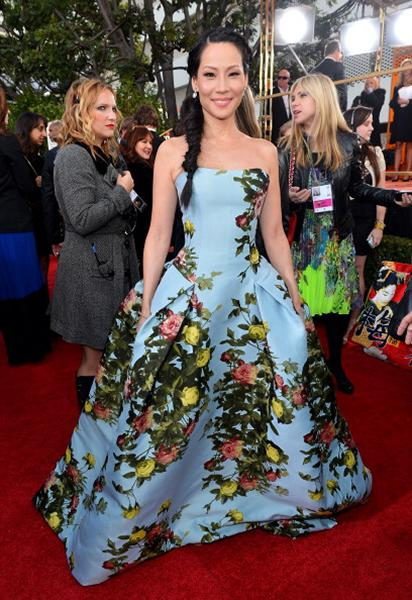"""<div class=""""caption-credit""""> Photo by: Getty Images</div><div class=""""caption-title""""></div><b>WORST: Lucy Liu</b> <br> We don't mind the floral print, but in a long dress it really does look like Liu is wearing drapes. If this Carolina Herrera were above the knee it maybe could have worked. <br>"""
