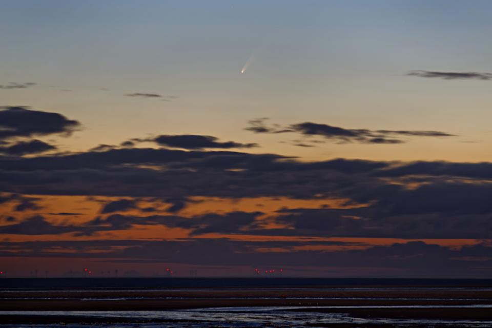 The comet seen from Brancaster Beach, Norfolk (Getty)