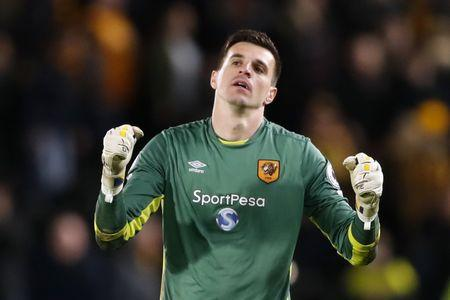Hull City's Eldin Jakupovic celebrates after the match Action Images via Reuters / Carl Recine