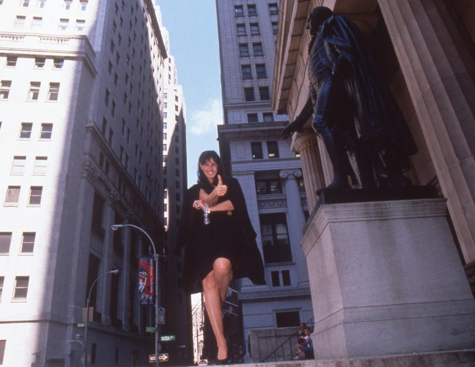 Donna Karan posing with a statue of George Washington on June 29, 1996—the first day her company traded on the New York Stock Exchange. Photographed for Life magazine.