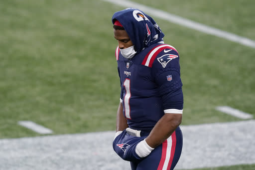 New England Patriots quarterback Cam Newton stands on the sideline in the second half of an NFL football game against the Buffalo Bills, Monday, Dec. 28, 2020, in Foxborough, Mass. (AP Photo/Elise Amendola)