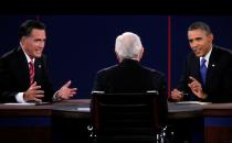FILE PHOTO: U.S. Republican presidential nominee Romney and U.S. President Obama speak at the same time as moderator Schieffer listens during the final U.S. presidential debate in Boca Raton