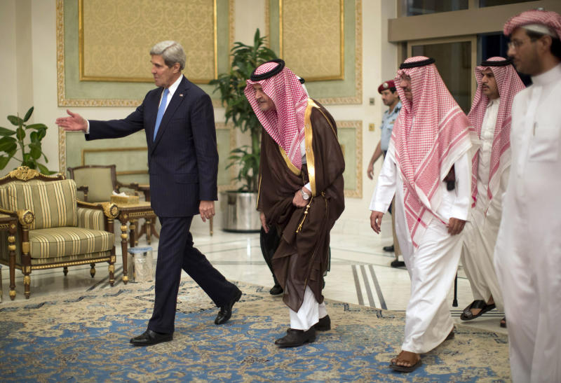 "FILE-In this Sunday, Nov. 3, 2013 file photo, U.S. Secretary of State John Kerry, left, is greeted by Saudi Foreign Minister Prince Saud Al-Faisal bin Abdulaziz al-Saud, after Kerry arrived in Riyadh, Saudi Arabia. In an unexpected consequence of the global diplomacy over Iran, Israel and Gulf Arab states led by Saudi Arabia are boosting back-channel contacts and finding increasing common ground over their mutual dismay with Tehran's drive to mend ties with the West and reach a nuclear deal. The ""strange alliance"" _ in the word of one former diplomat _ highlights how the ripples from Iran are driving some allies apart while pushing foes closer. It also highlights the Sunni world's distress at the possibility of a bomb in the hands of a Shiite power. (AP Photo/Jason Reed, Pool, File)"