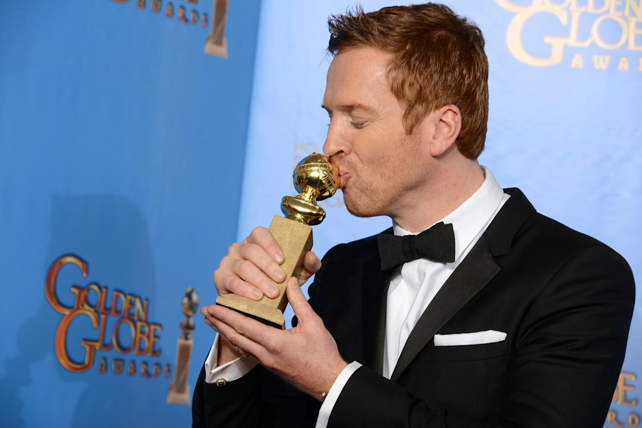 """Damian Lewis poses with the award for best performance by an actor in a television series – drama for """"Homeland"""" backstage at the 70th Annual Golden Globe Awards at the Beverly Hilton Hotel on Sunday Jan. 13, 2013, in Beverly Hills, Calif. (Photo by Jordan Strauss/Invision/AP)"""