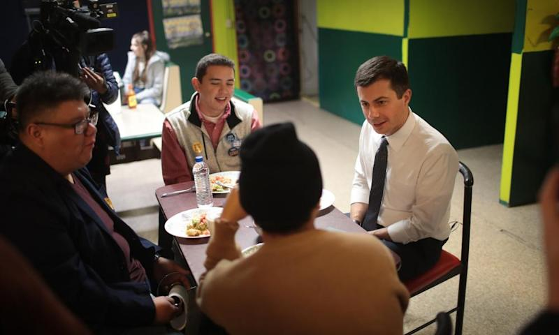 Buttigieg eats lunch with voters in Iowa, where he is now the frontrunner in the state's Democratic primary.