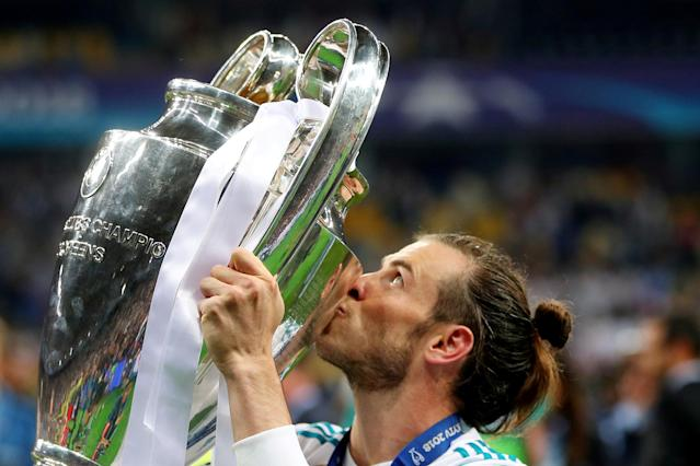 Soccer Football - Champions League Final - Real Madrid v Liverpool - NSC Olympic Stadium, Kiev, Ukraine - May 26, 2018 Real Madrid's Gareth Bale celebrates winning the Champions League by kissing the trophy REUTERS/Hannah McKay TPX IMAGES OF THE DAY
