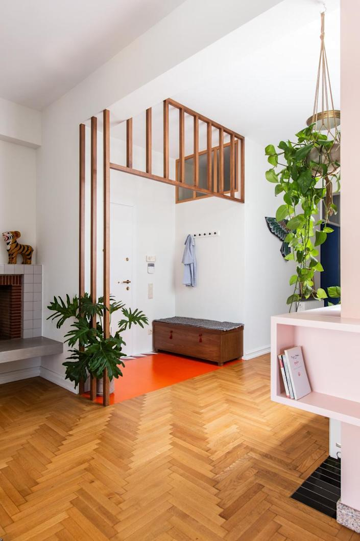 Simple wooden entry area inside Point Supreme's renovated Athens apartment.