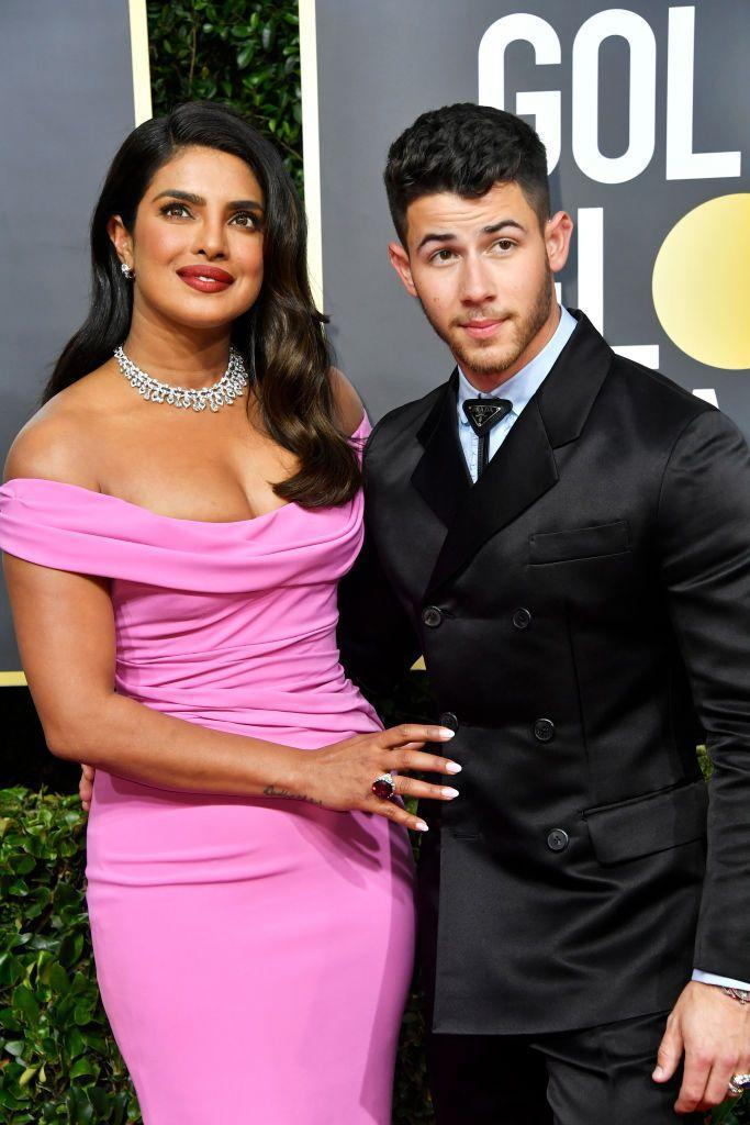 <p>The couple attended, and presented an award together, at the 2020 Golden Globes. Priyanka wore a pink off-the-shoulder gown by Cristina Ottaviano with Bulgari jewellery.</p>