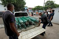 Brazilian health workers receive oxygen cylinders at a hospital in Manacapuru, Amazonas state on January 20, 2021
