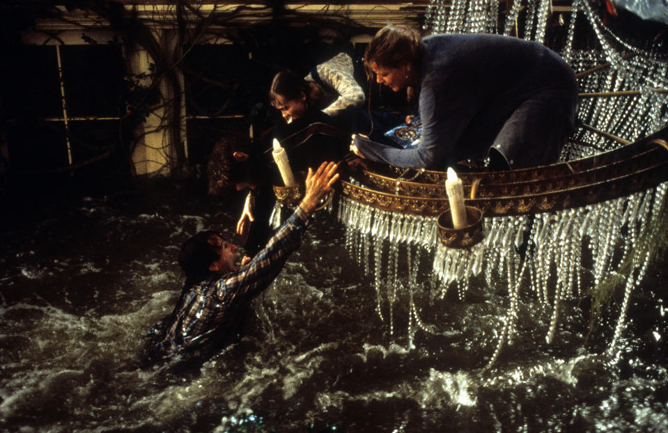 Robin Williams hangs onto Bradley Pierce, Kirsten Dunst and Bonnie Hunt in a scene from the film 'Jumanji', 1995. (Photo by TriStar/Getty Images)