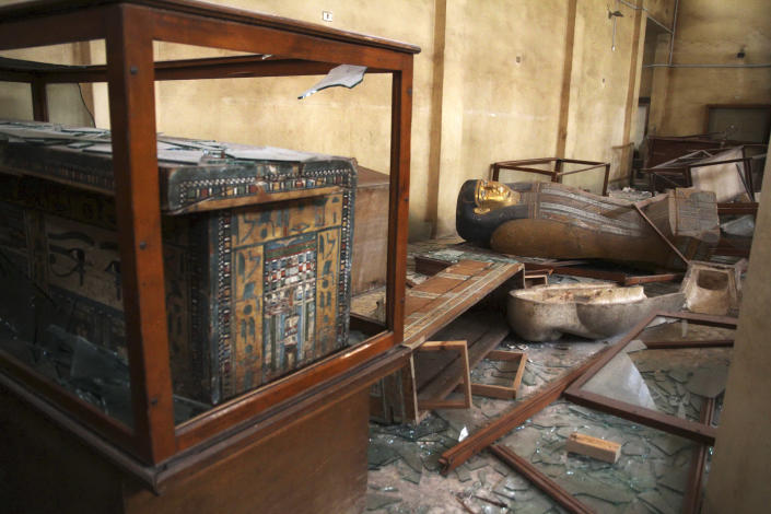 Damaged pharaonic objects lie on the floor and in broken cases in the Malawi Antiquities Museum after it was ransacked and looted between the evening of Thursday, Aug. 15 and the morning of Friday, Aug. 16, 2013, in Malawi, south of Minya, Egypt, Saturday, Aug. 17, 2013. The interim Cabinet authorized police to use deadly force against anyone targeting police and state institutions on Thursday. The violence capped off a week that saw more than 700 people killed across the country. (AP Photo/Roger Anis, El Shorouk Newspaper) EGYPT OUT