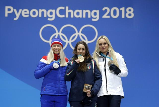 Medals Ceremony - Alpine Skiing - Pyeongchang 2018 Winter Olympics - Women's Downhill - Medals Plaza - Pyeongchang, South Korea - February 21, 2018 - Gold medalist Sofia Goggia of Italy, silver medalist Ragnhild Mowinckel of Norway and bronze medalist Lindsey Vonn of the U.S. on the podium. REUTERS/Eric Gaillard