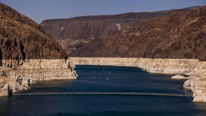 Minerals deposited on previously submerged surfaces marked the shoreline of the Colorado River during low water levels in Arizona, Nev., in August.