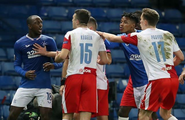 Kamara, left, argues with Kudela after the incident at Ibrox