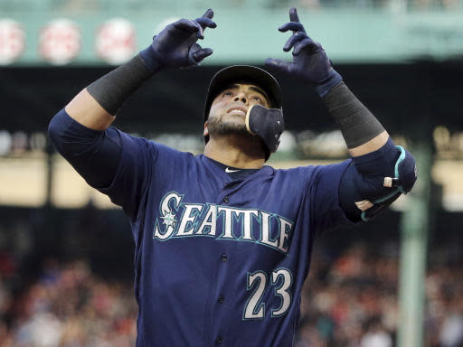 Seattle Mariners designated hitter Nelson Cruz celebrates his three-run home run during the first inning of the team's baseball game against the Boston Red Sox at Fenway Park, Friday, June 22, 2018, in Boston. (AP Photo/Elise Amendola)