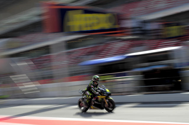 Monster Yamaha Tech 3's British Cal Crutchlow leaves the pits at the Catalunya racetrack in Montmelo, near Barcelona, on June 2, 2012, during the MotoGP third training session of the Catalunya Moto GP Grand Prix. AFP PHOTO / JOSEP LAGOJOSEP LAGO/AFP/GettyImages