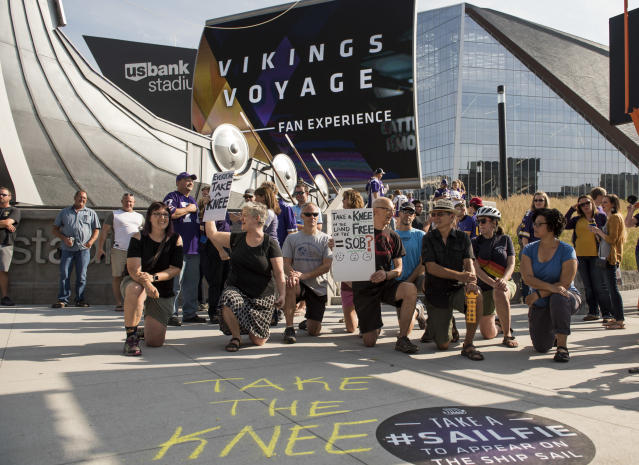 <p>Protestors kneel outside U.S. Bank Stadium before the Minnesota Vikings game in Minneapolis, Minnesota. The protest, in support of Colin Kaepernick, comes days after disparaging statements made by President Donald Trump about players taking a knee during the National Anthem. (Photo by Stephen Maturen/Getty Images) </p>