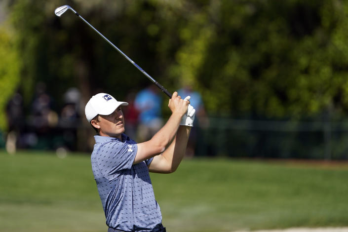 Jordan Spieth follows his approach shot to the ninth green during the second round of the Arnold Palmer Invitational golf tournament Friday, March 5, 2021, in Orlando, Fla. (AP Photo/John Raoux)