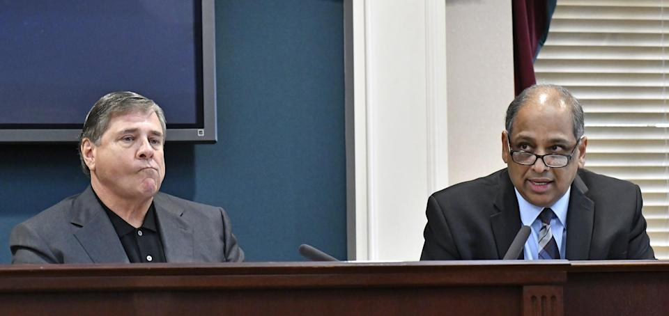University of Louisville athletic director Tom Jurich (left) and acting Louisville president Neville Pinto. (AP)